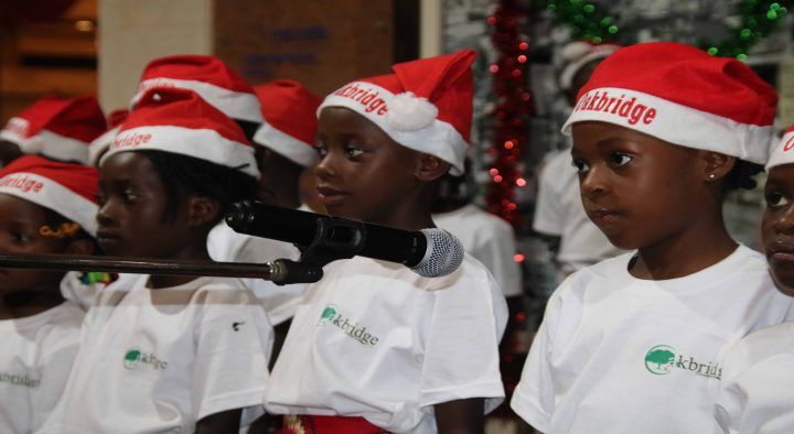 OAKBRIDGE FOUNDATION CHILDREN MAKE A SECOND APPEARANCE AT THE HILTON TREE LIGHTING EVENT.